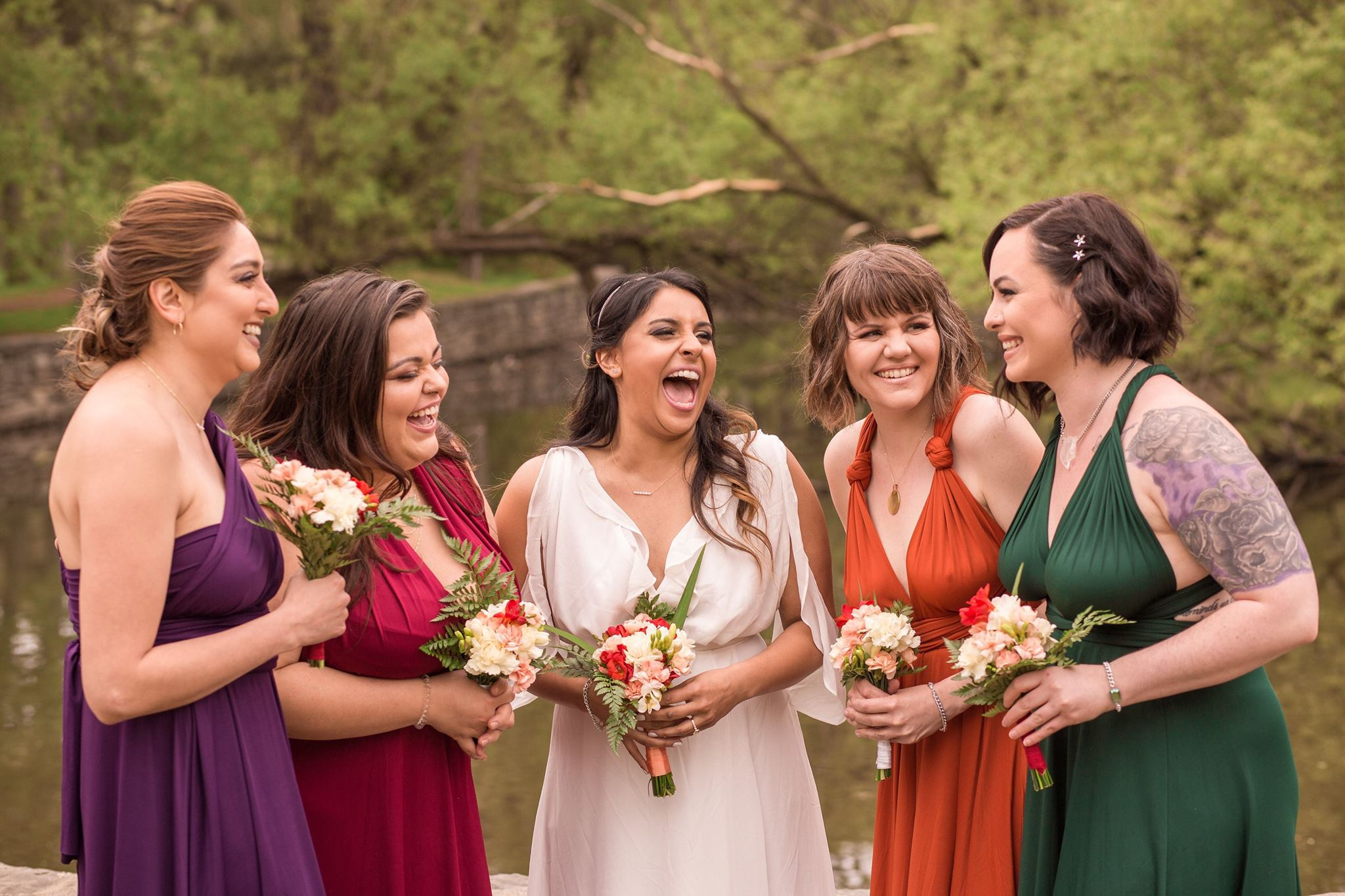 BridesMade bride with her bridesmaids dressed in fall colours