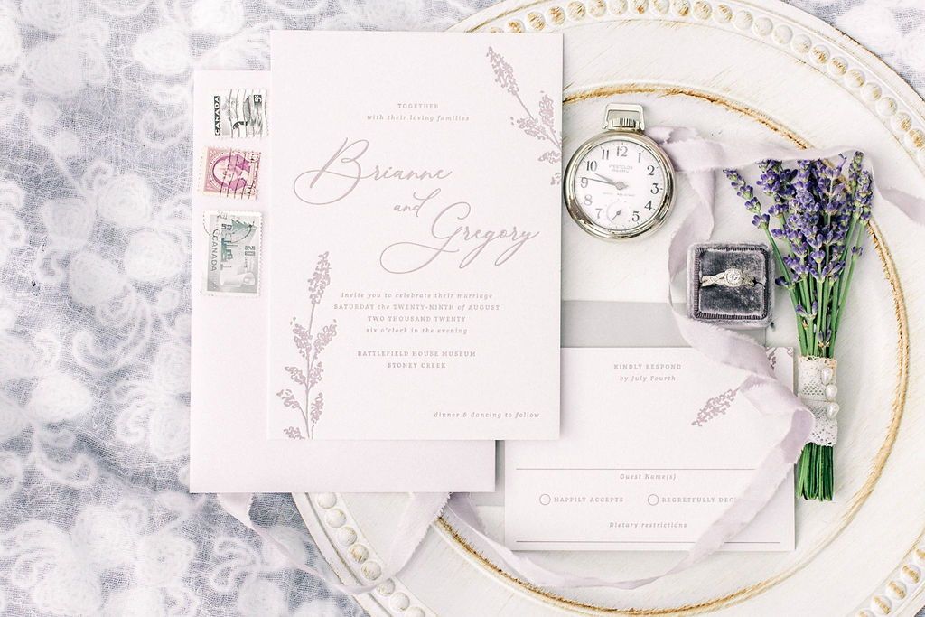 vintage invitation set with old stamps, pocketwatch and chalk painted platter