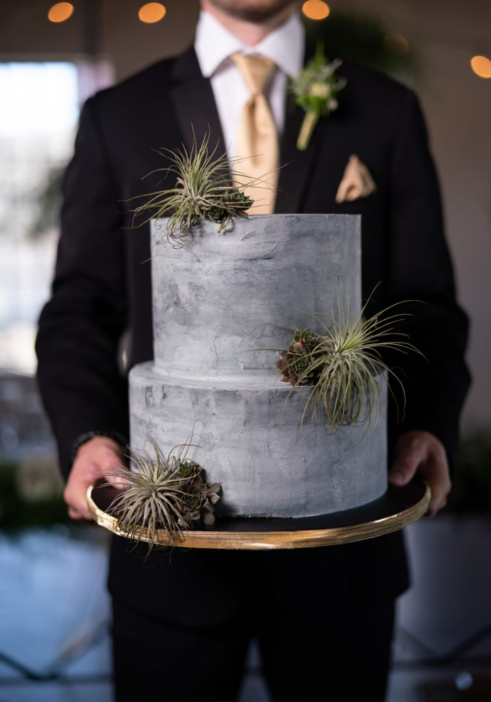I'm so in love with this buttercream concrete cake, complete with fresh succulents.