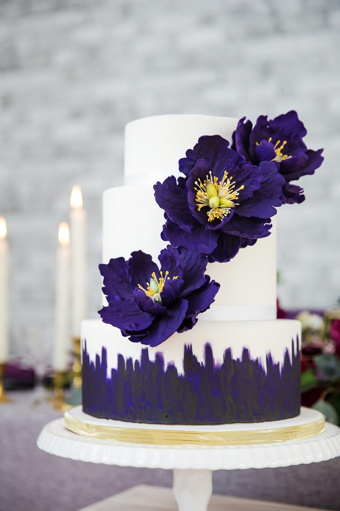 Large deep purple sugar peony's make a statement on this handpainted cake.