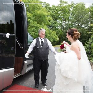 chauffeur Colin helping a bride into the brentwood livery limobus