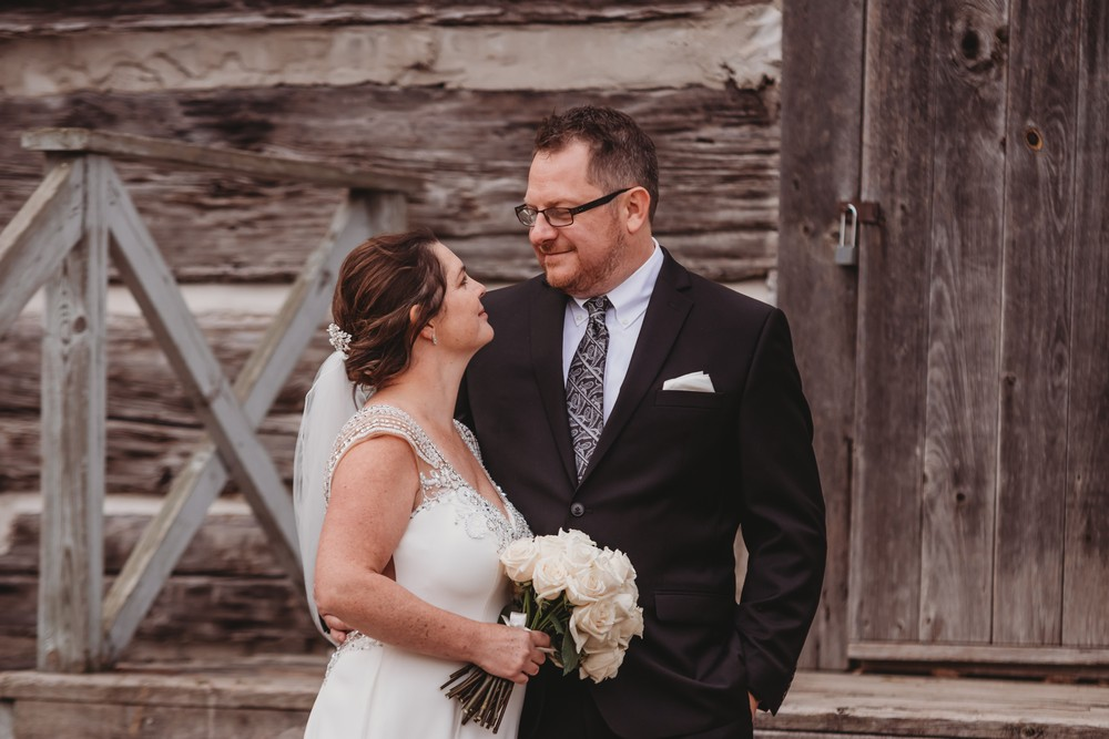 understated elegance at Delta Waterloo, bride and groom against wood wall