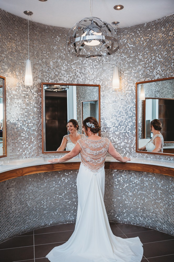 bride in front of sparkle tile wall with mirrors Delta Waterloo