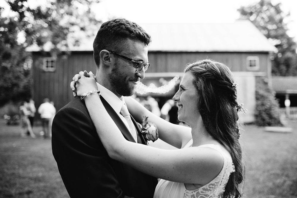 bride and groom dancing in the barn at fanshawe pioneer village