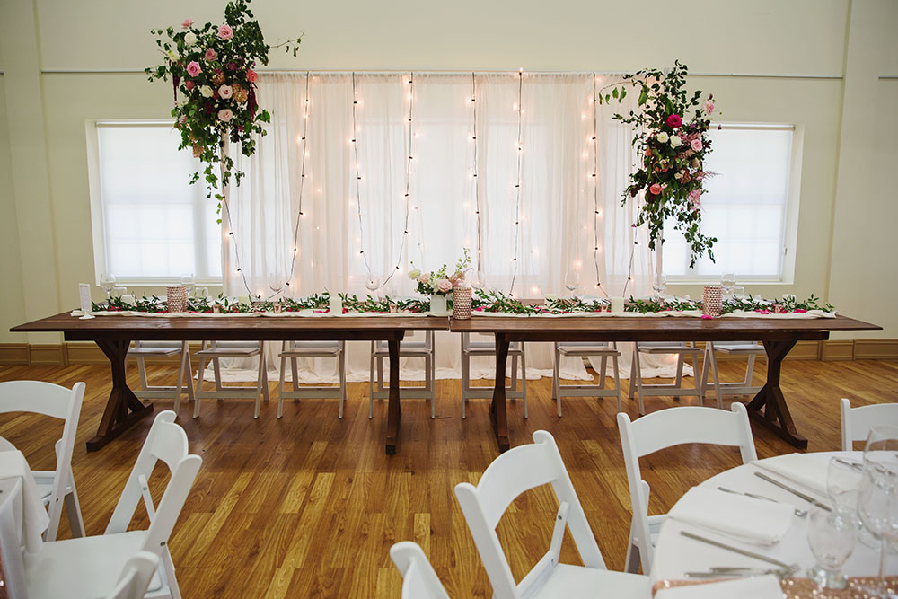 beautiful backdrop with florals in the Trillium Gallery at Fanshawe Pioneer Village