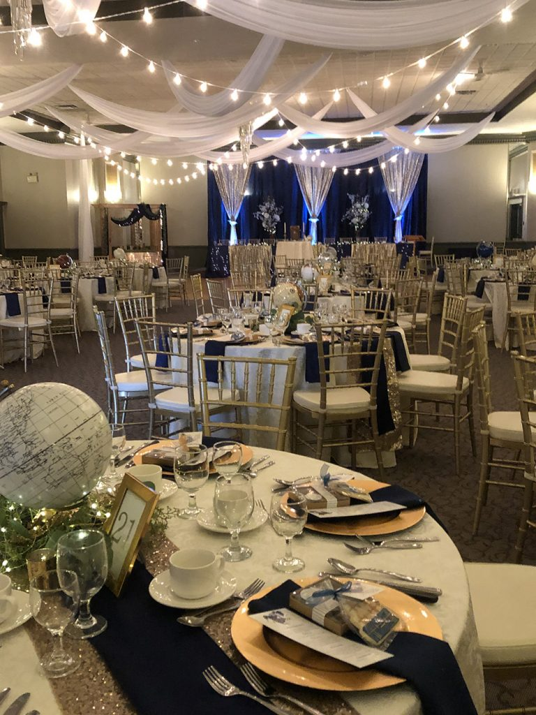 wedding reception ceiling decor with lights and white fabric