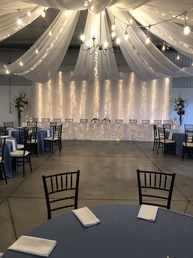 head table wedding decor with lights and ceiling canopy now & always