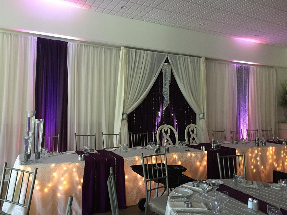 purple, white and lights wedding decor now & always
