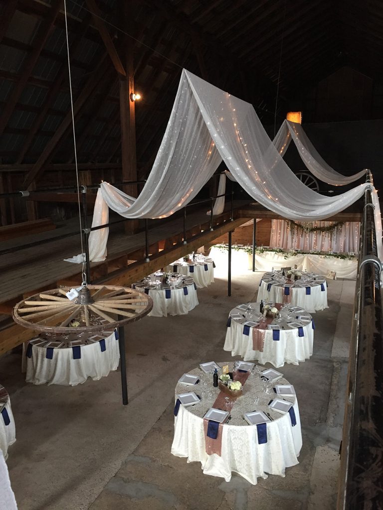 barn wedding decor with ceiling canopy