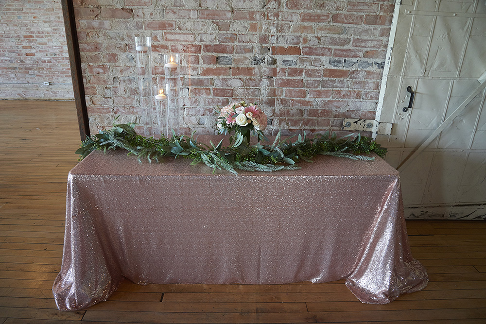 rose coloured headtable against a brick wall now & always