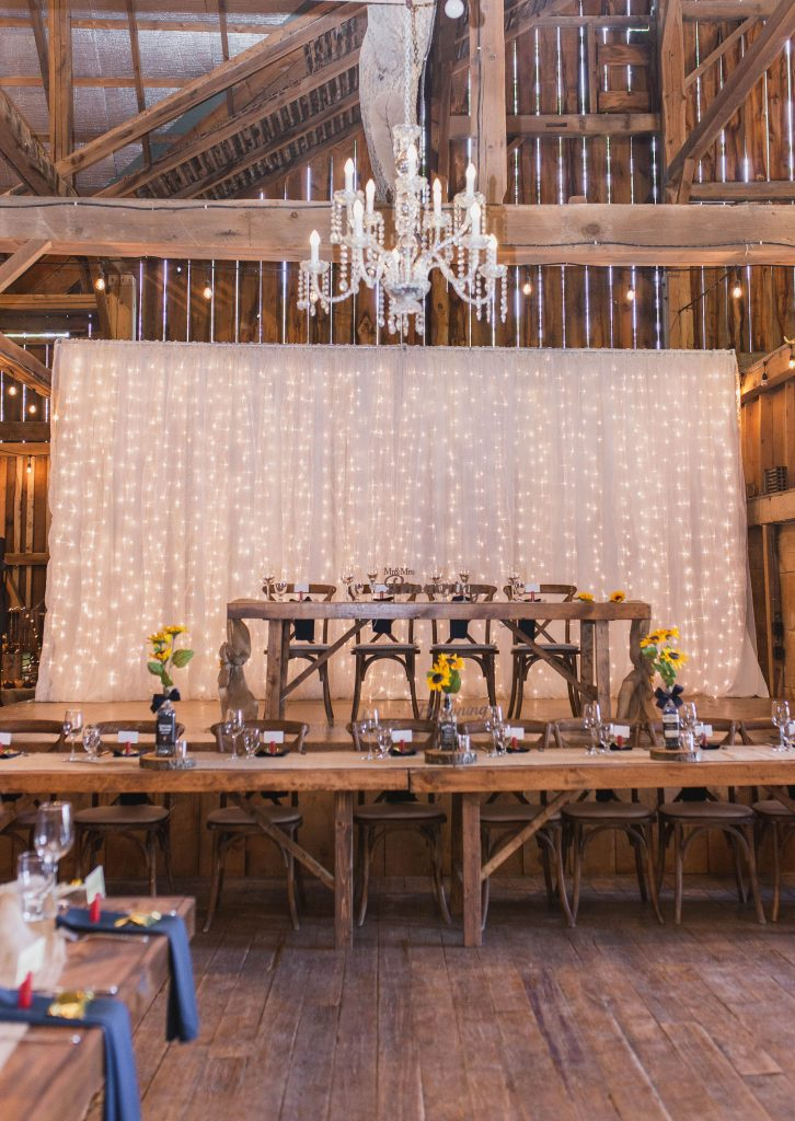 rustic fabric backdrop with twinkle lights in a barn