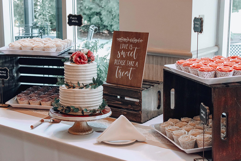 Can't decide between a wedding cake and cupcakes? Choose both! With this beautiful, rustic dessert table.