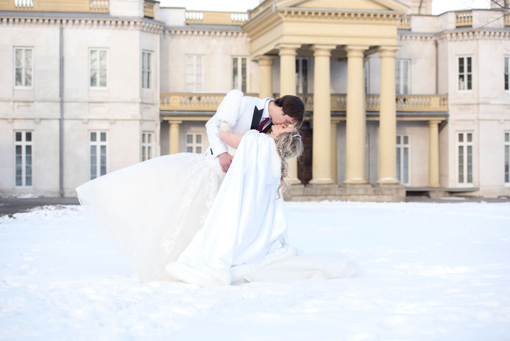 Winter White Wedding Simple Wedding photography bride and groom kissing in the snow