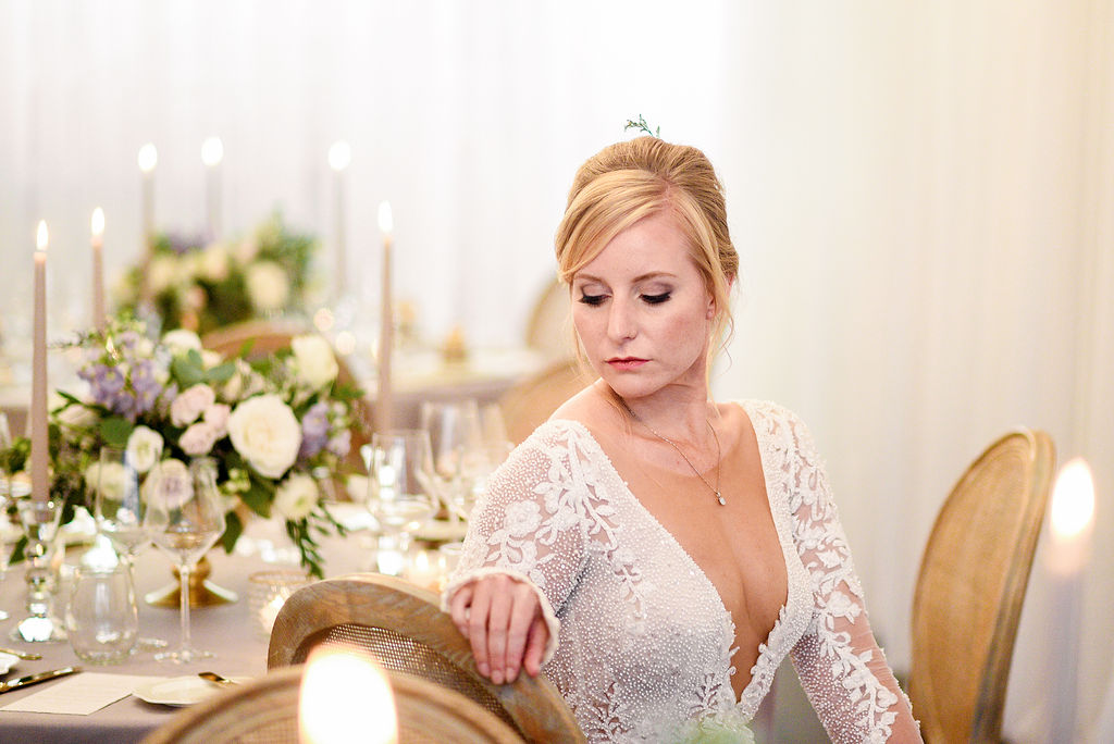 The Flowers are Still blooming Julie Nicole Photography La Petite Fleur Bride sitting at beautiful wedding table