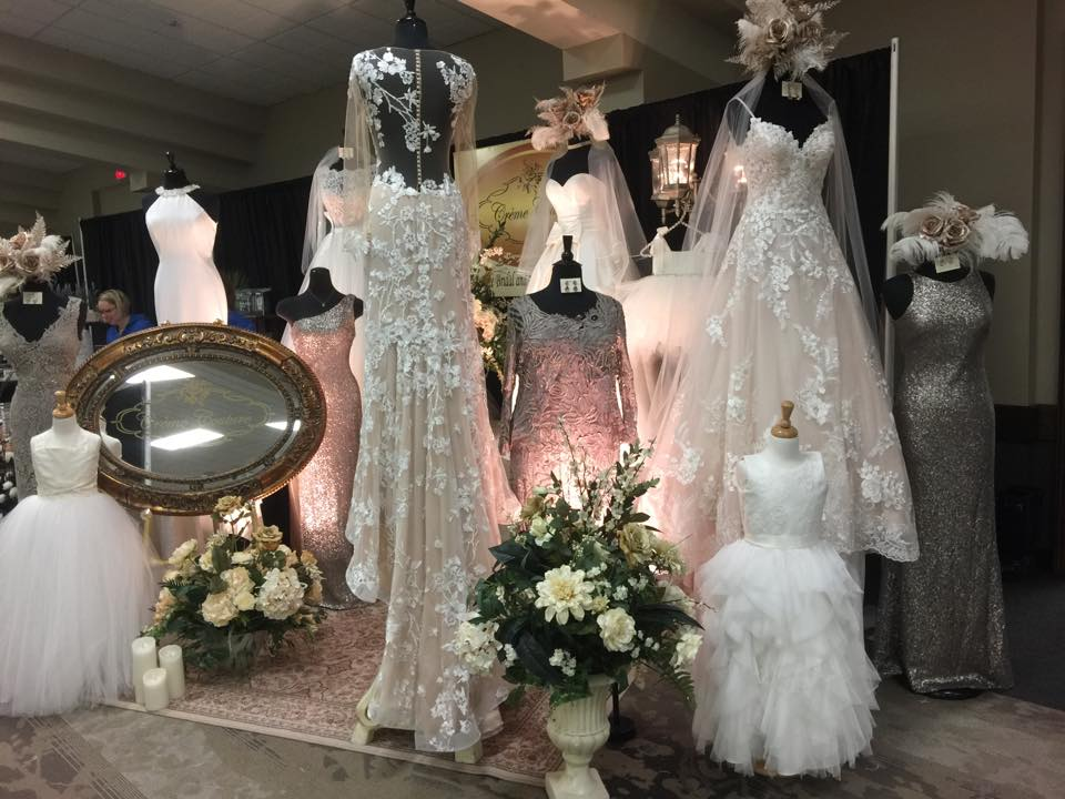 creme couture bridal show display of wedding gowns, flowergirl dresses and bridesmaid dresses