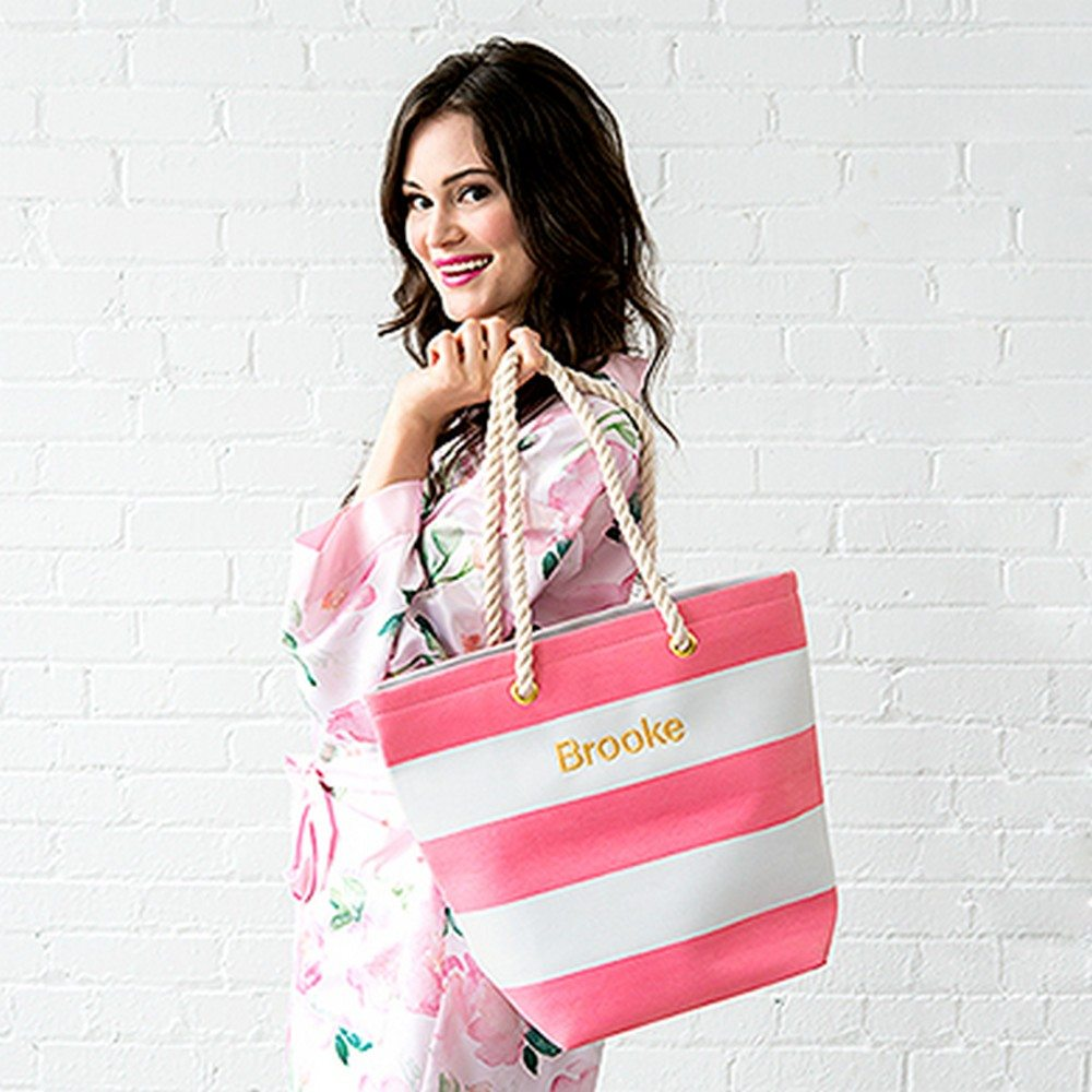 "Stylish and practical this fresh, bold striped tote is ideal for a day at the beach, lounging around the pool or just simply commuting in the city. Whether for yourself or your best gals, here is a great gift with a little bit of ""bliss"" built in. Multiple colours available and can also be personalized! $20.98 each."